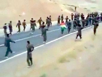 Binlerce Kürt asker Suriye'ye geçti
